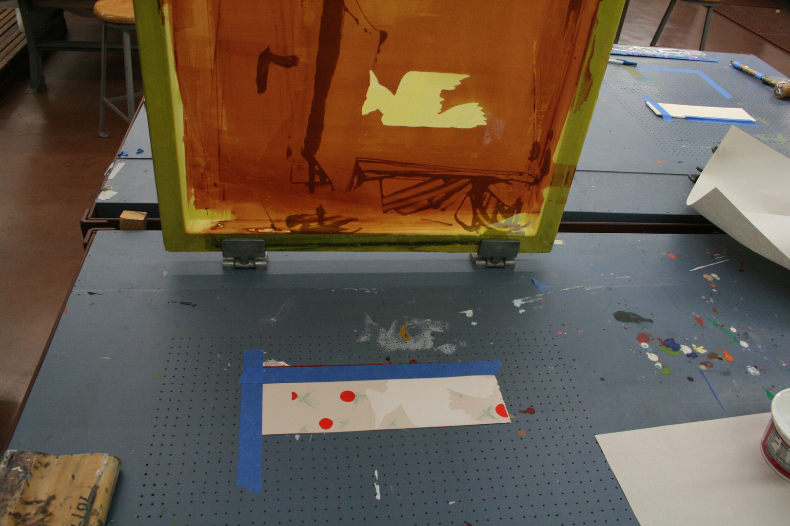 Pushing ink through the stencil