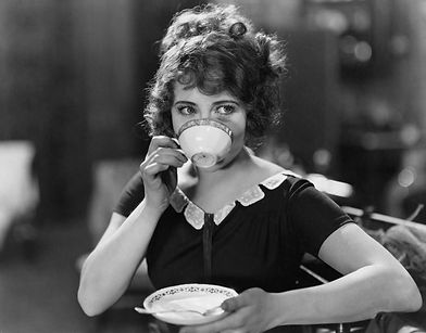 Portrait of woman drinking from teacup.j