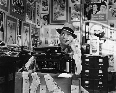 Man thinking at typewriter.jpg