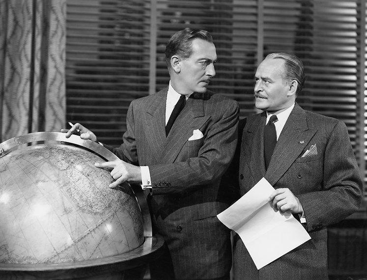 Businessmen with globe.jpg