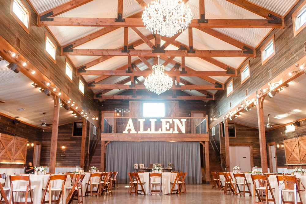 Marquis lights spelling the newlywed's last name brighten the barn venue.