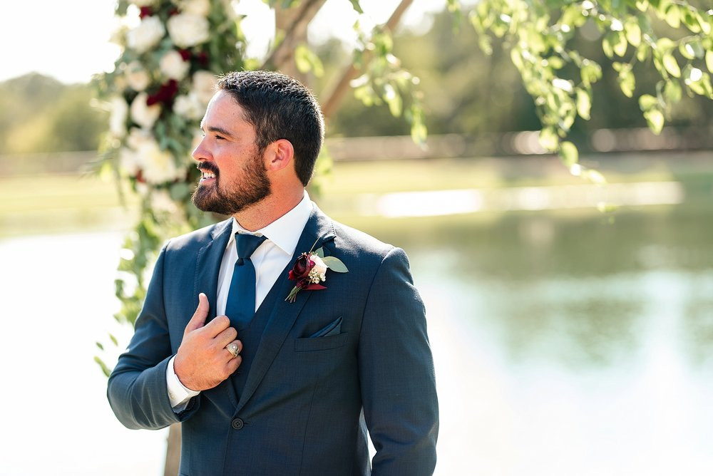 The groom's maroon boutonniere posed a striking visual juxtaposition against his navy suit.