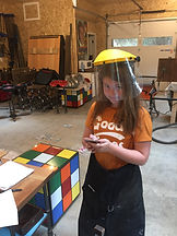 Ava Wilson working in the Madrona Bay Decor Studio.