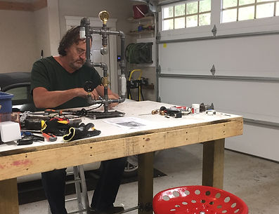 Building a steam punk lamp at Madrona Bay Decor studio.
