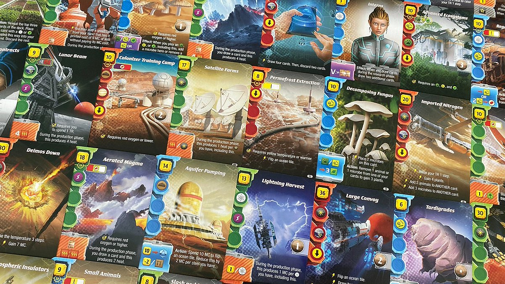 A selection of cards from the game Terraforming Mars Ares Expedition