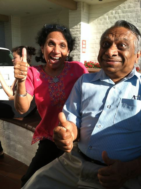 Mom and Dad give a thumbs up.