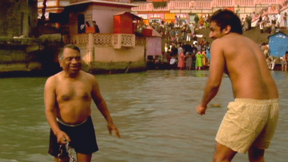 Dad and Ravi take a bath in the Ganges.