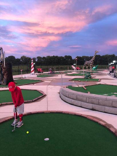 Grant Playing Mini Golf at Night.jpg