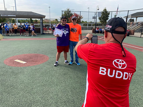 Buddy - Taking Picture of Player at Medal Ceremony Over Shoulder.JPEG
