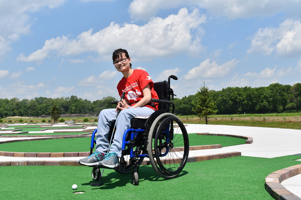 Kylie in Wheelchair Putting.jpg