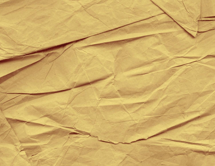 crumpled yellow paper used as a metaphor for logo design and rough sketches.