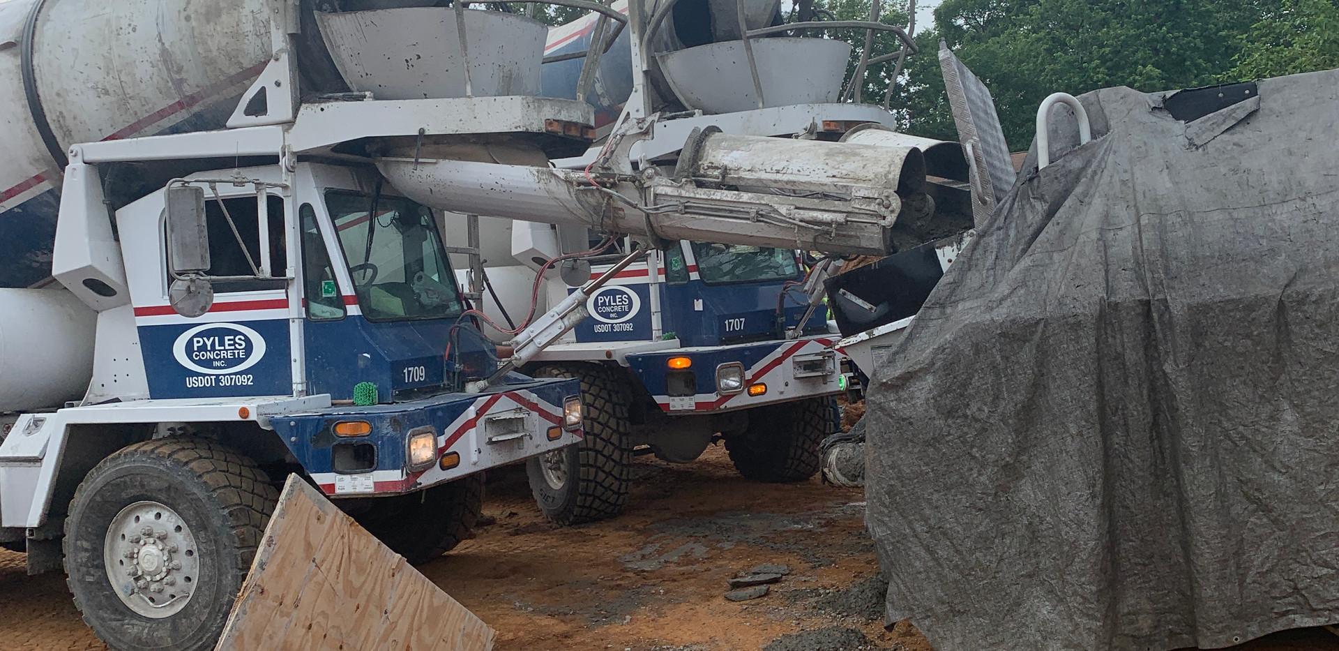 Pyles Concrete Mixer Trucks Pouring Into Pump.