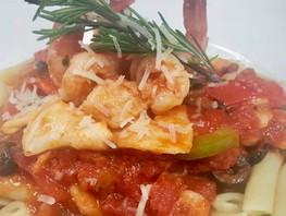 Seafood Creole served on Penne