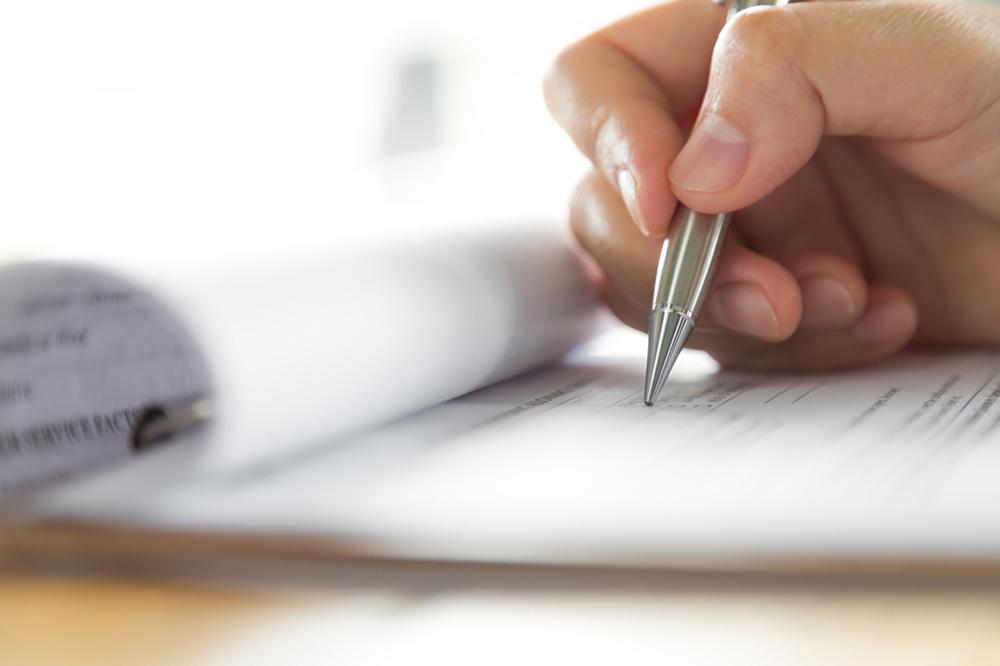 Hånd med penn som dokumenterer