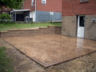 Wall and stamped concrete after