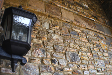 Old Lantern against a Stone Wall
