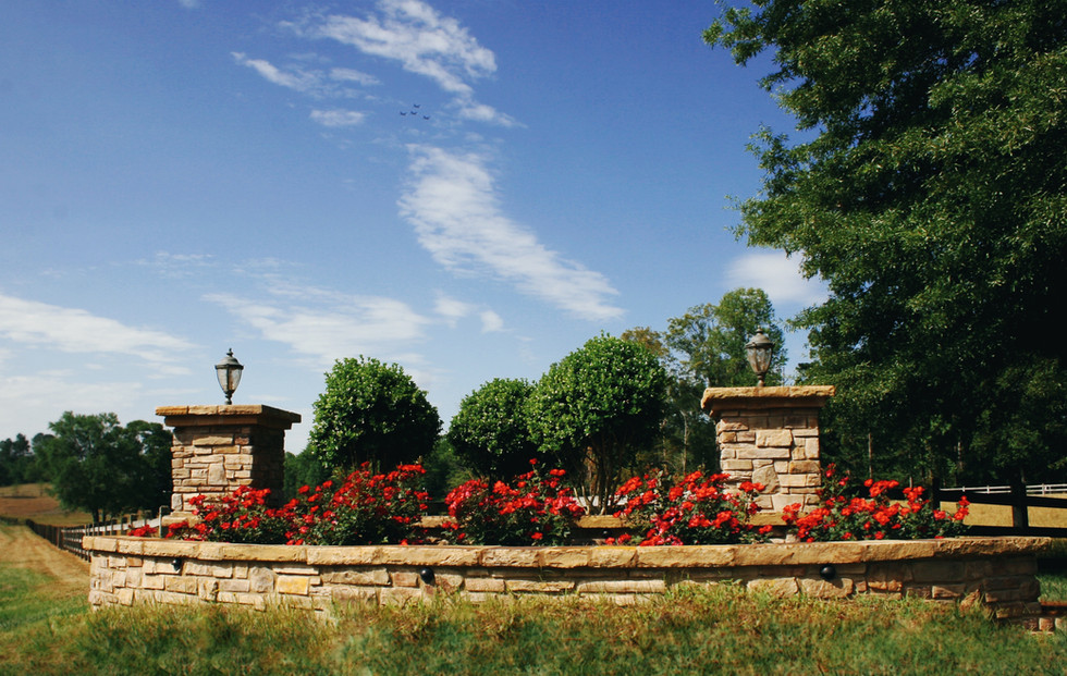 Raised Stone Garden with Pillars
