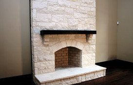 White Stone Fireplace with Mantel