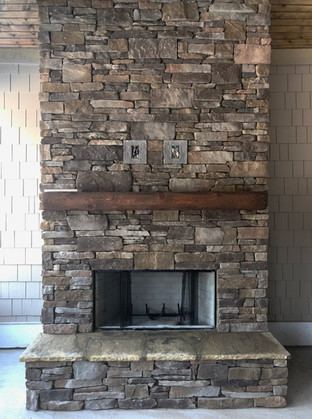 Beam Mantel on Stone Fireplace