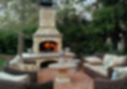 Outdoor Stone Fireplace Blazing