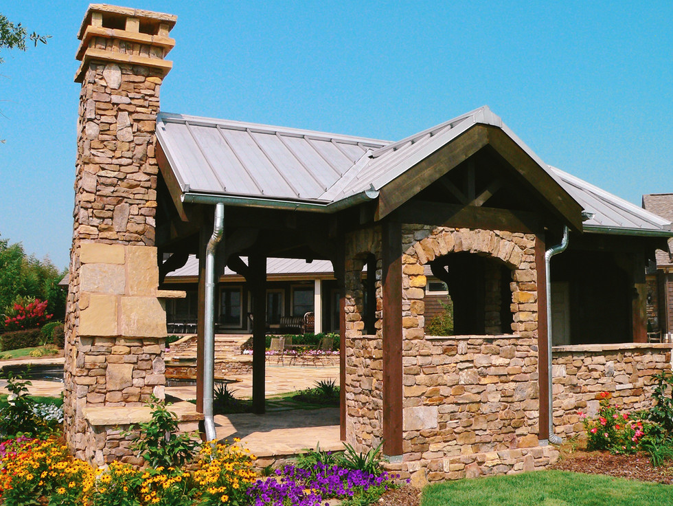Covered Stone Fireplace Pool House
