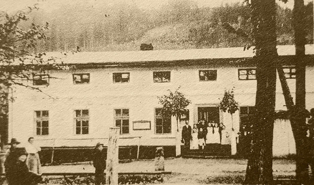 Former owner František Just and staff outside the pub, c.1917