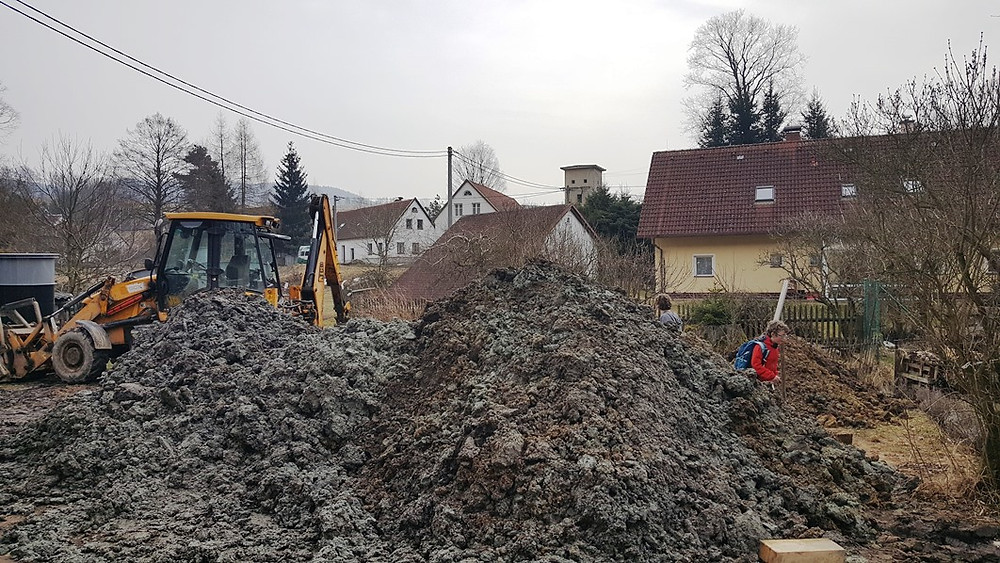 Burying the septic tank and destroying the road: lone boy surveys the damage