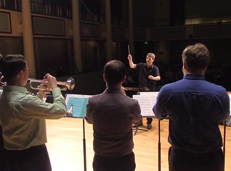 Trumpet Ensemble Conducting Dances at Dusk