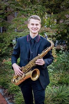 Daniel Armistead holding Tenor Saxophone