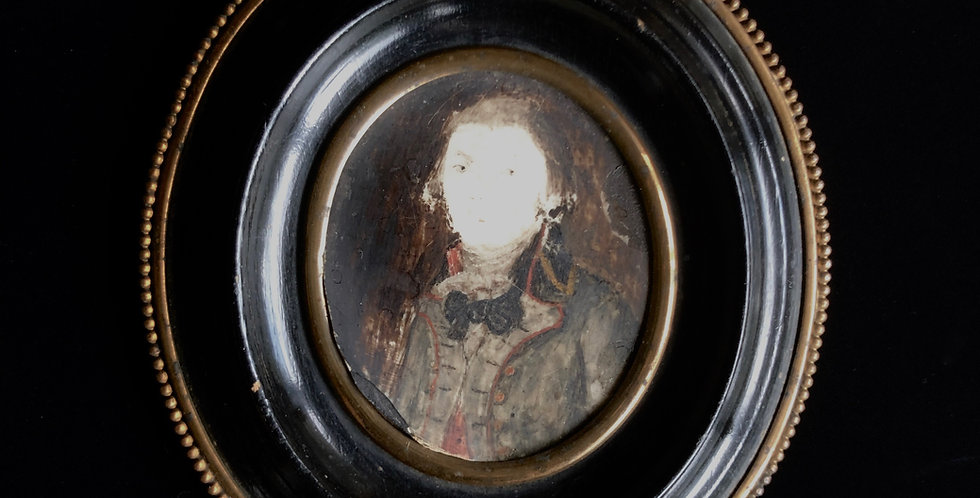 Black oval frame portrait