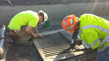 Installation crew of Virginia Carolina Belting working onsite to install heavy duty conveyor belt.