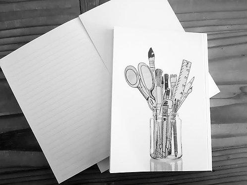 מחברת מעוצבת-כלי כתיבה בכוס
