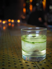 Cucumber cocktail from itimate Chicago neighborhood bar in Lincoln Square and Ravenswood. Dark and intimate first date spot in the city