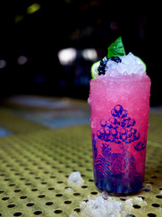 Cool colorful pink unique shaved ice cocktail from The Sixth an intimate Chicago neighborhood cocktail bar in Lincoln Square and ravenswood