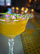 Yellow cocktail with flowers Rutte Old Simssico, Date, Son Genever, Carpano Bianco, Gran Claage Intimate Chicago cocktail bar