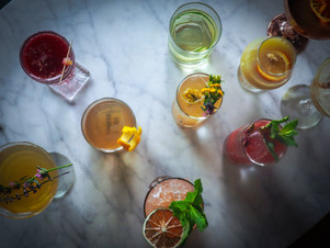 Cool instagrammable colorful cocktails from The Sixth bar in Chicago Lincoln Square neighborhood. Unique first date spot with fun cocktails with flowers