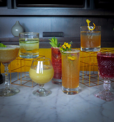 Cool instagrammable colorful cocktails from The Sixth bar in Chicago Lincoln Square neighborhood. Unique first date spot with fun cocktails with flowers and garnishes