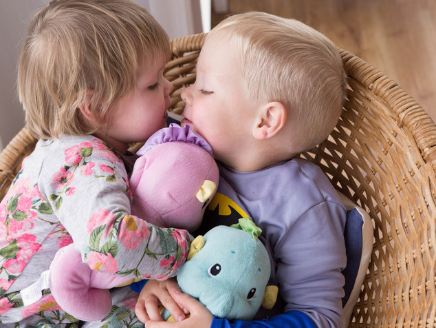 A sibling kiss
