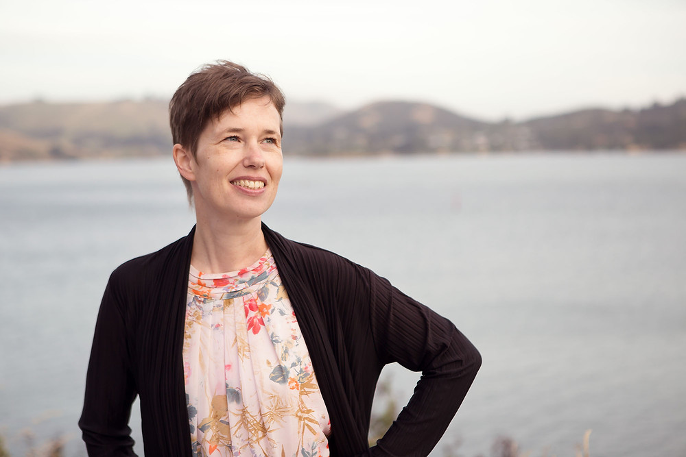 Headshot of a woman smiling at Otago Harbour, Dunedin