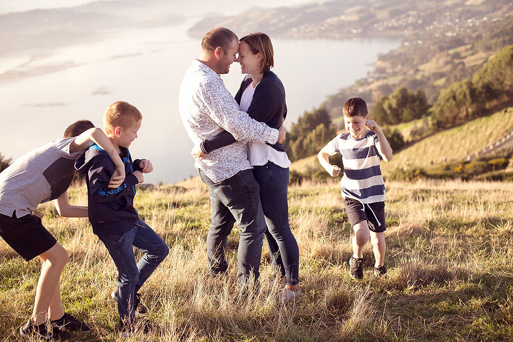 Family photo on Otago Peninsula overlooking the harbour and Dunedin