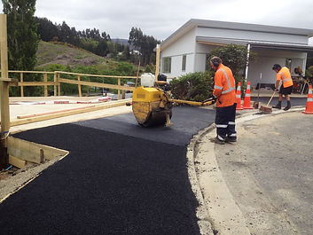 Work underway to asphalt a driveway and vehicle crossing in Dunedin