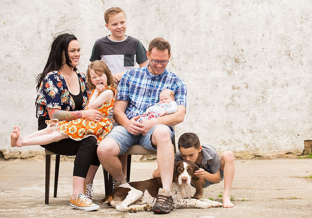 Relaxed and fun family picture with a dog