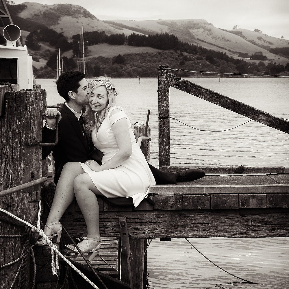 Bride and groom share a moment on their wedding day at Careys Bay, Dunedin