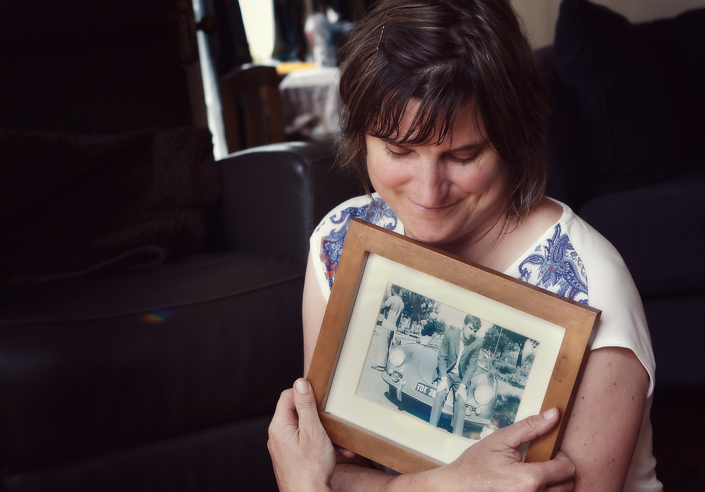 Dunedin photographer Edith Leigh embraces a picture of her father