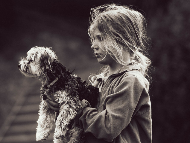 Lifestyle portrait of girl and dog