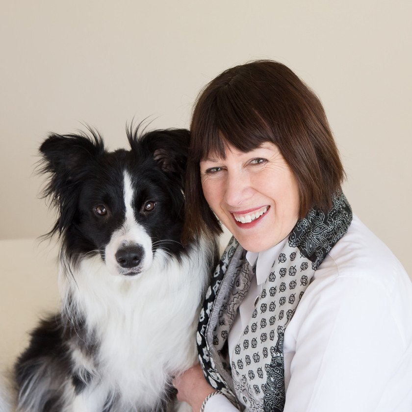 A Dunedin woman poses with her dog for her headshot