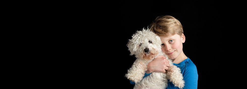 Boy and bichon frise dog_edited_edited.jpg