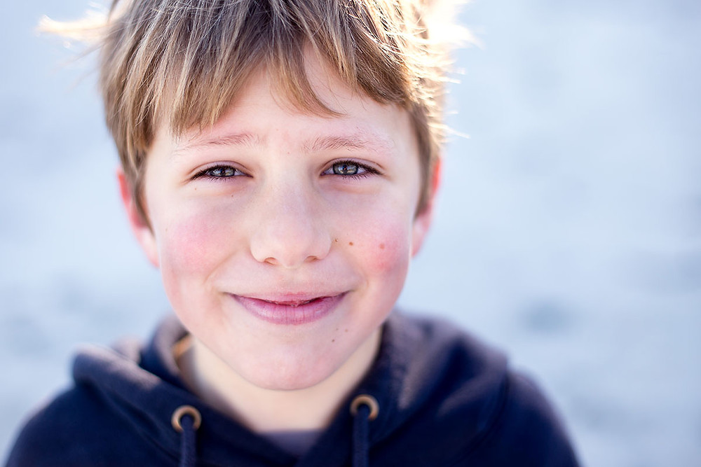 Children's portrait of a boy taken on the beach in Dunedin