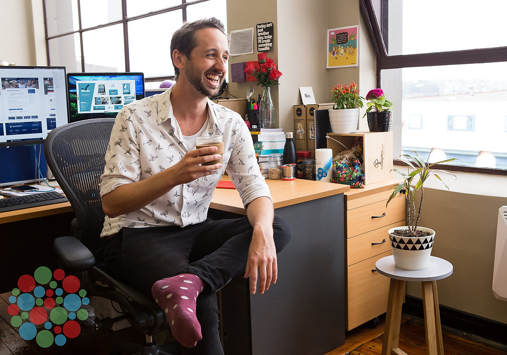 A creative entrepreneur shows his personality at his desk in the Petridish shared office space in Dunedin