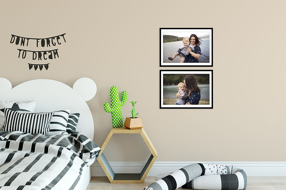 Family pictures on the wall in a child's bedroom
